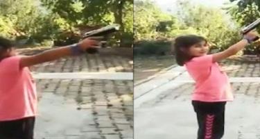Uşağın əlinə silah verdi: Ölümdən döndü - VİDEO