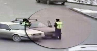 Avtomobillə yol polisini vurub kapotun üzərində 3 kilometr sürüdü - VİDEO