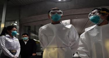 Virus xaosu: Etirazçılar koronavirus xəstələrinin binasına od vurdular - VİDEO